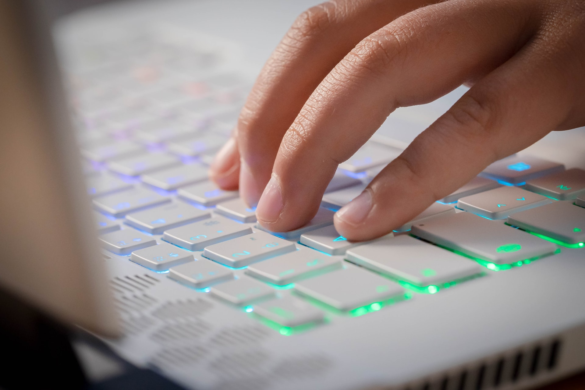 close up of hand typing on keyboard
